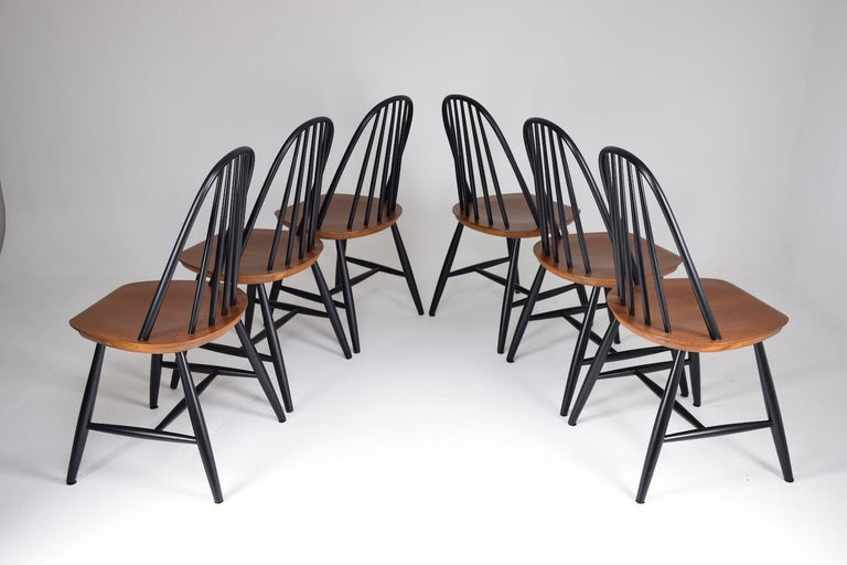 A 20th-century vintage set of Scandinavian dining chairs manufactured by Hagafors in the 1960s composed of teak and designed with a rounded panel backrest in black lacquer.   -------  We are an exhibition space and an online destination established