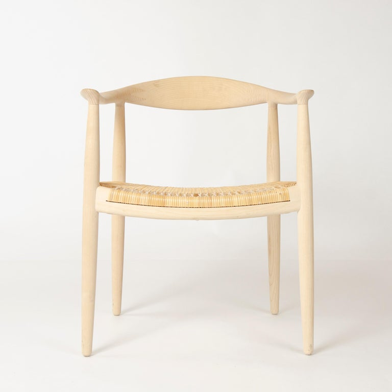 A set of 6 custom height PP501 round chairs with sculpted back and arms in ash with a caned seat.