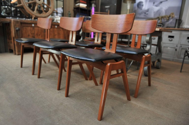 Set of six Scandinavian great shape teak and faux leather chairs, circa 1960 all in excellent condition and very stabile. Measure: Height seat 46 cm.
