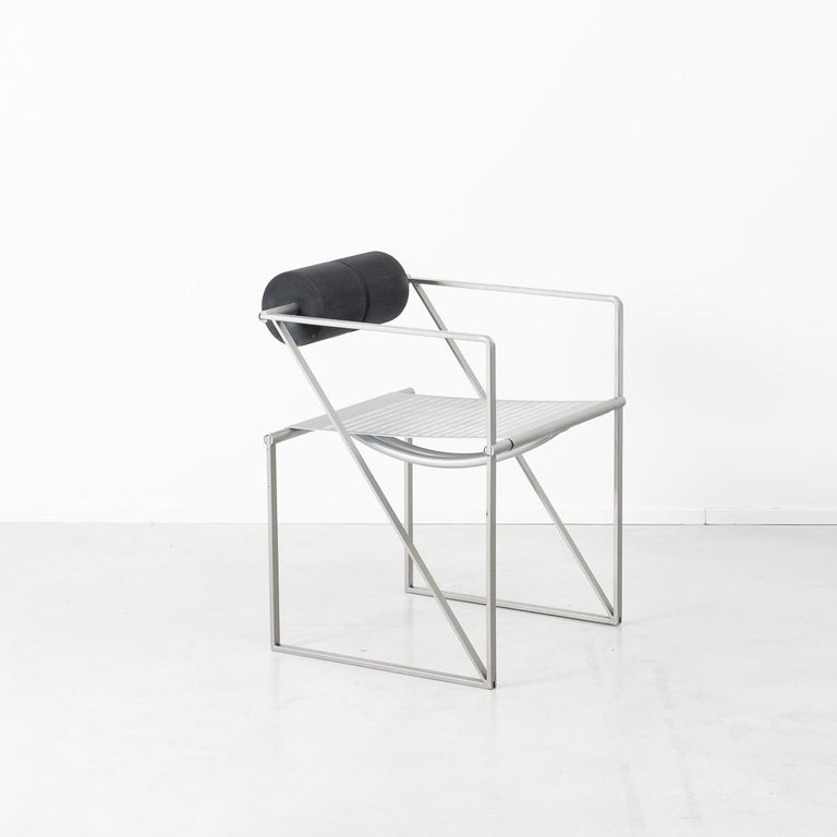 The Seconda chair is perhaps one of his most iconic pieces. This set of early period produced chairs are, like most of his designs, are made from metal tubing, flat bar and folded perforated sheet metal. The Seconda chair also noticeably features a