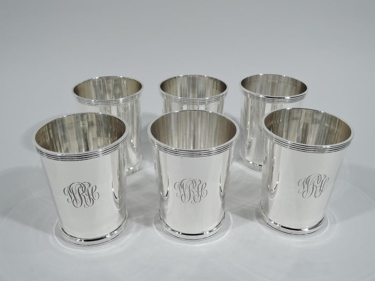 Set of 6 sterling silver mint julep cups. Made by Stieff in Baltimore. Each: Straight and tapering sides, and reeded rim and foot. Engraved interlaced script monogram. Fully marked including no. 0701 and date letters spanning 1940s and 1950s. Total