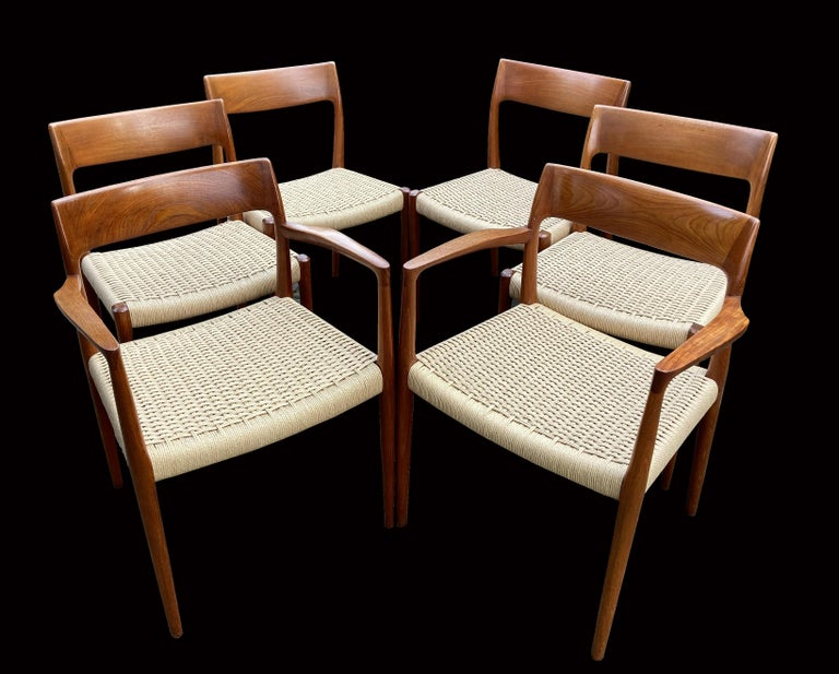These are a fabulous and early original set of diners by the most famous dining chair designer Niels O. Moller, they are called model 77 ( The ones with no arms) and model 57 (the arm version).