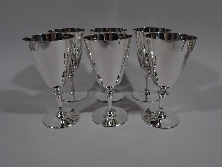 Set of 6 modern sterling silver goblets. Made by Tiffany & Co. in New York. Each: Conical bowl with knopped tapering stem and flat circular foot. Easy grip with nice balance. Fully marked including pattern no. 20168. Five goblets have director's