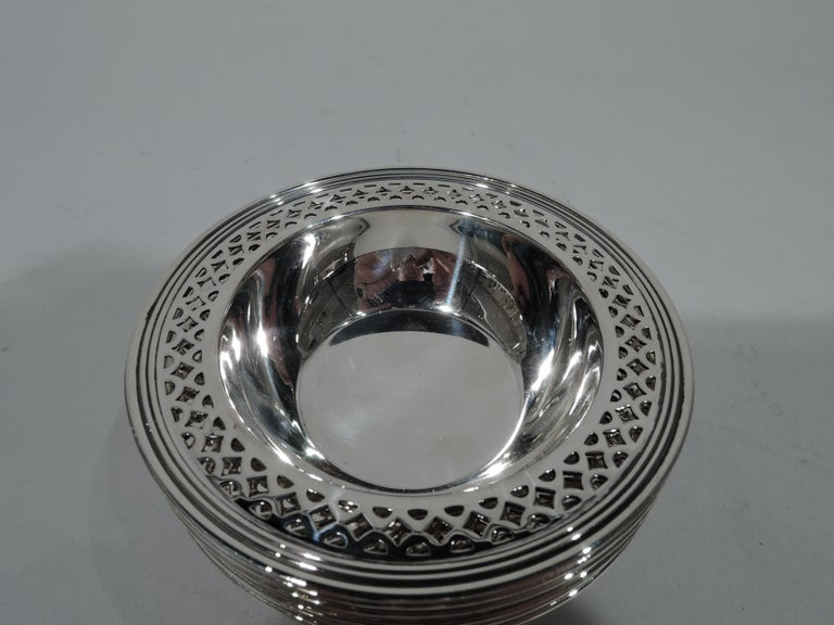 Set of 6 Art Deco sterling silver nut dishes. Made by Tiffany & Co. in New York, circa 1922. Each: Solid and tapering well and flat rim with geometric piercing and reeding. Hallmark includes pattern no. 20096K (first produced in 1922) and director's