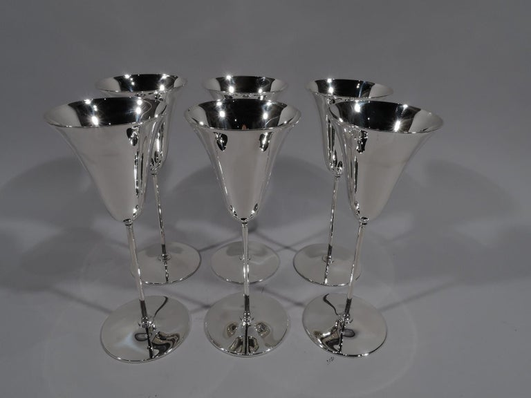 """Set of 6 Art Deco sterling silver flutes. Made by Tiffany & Co. in New York, circa 1924. Each: Conical """"tulip"""" bowl on thin cylindrical shaft mounted to flat circular foot. For chic sipping. Fully marked including pattern no. 20468 (first produced"""