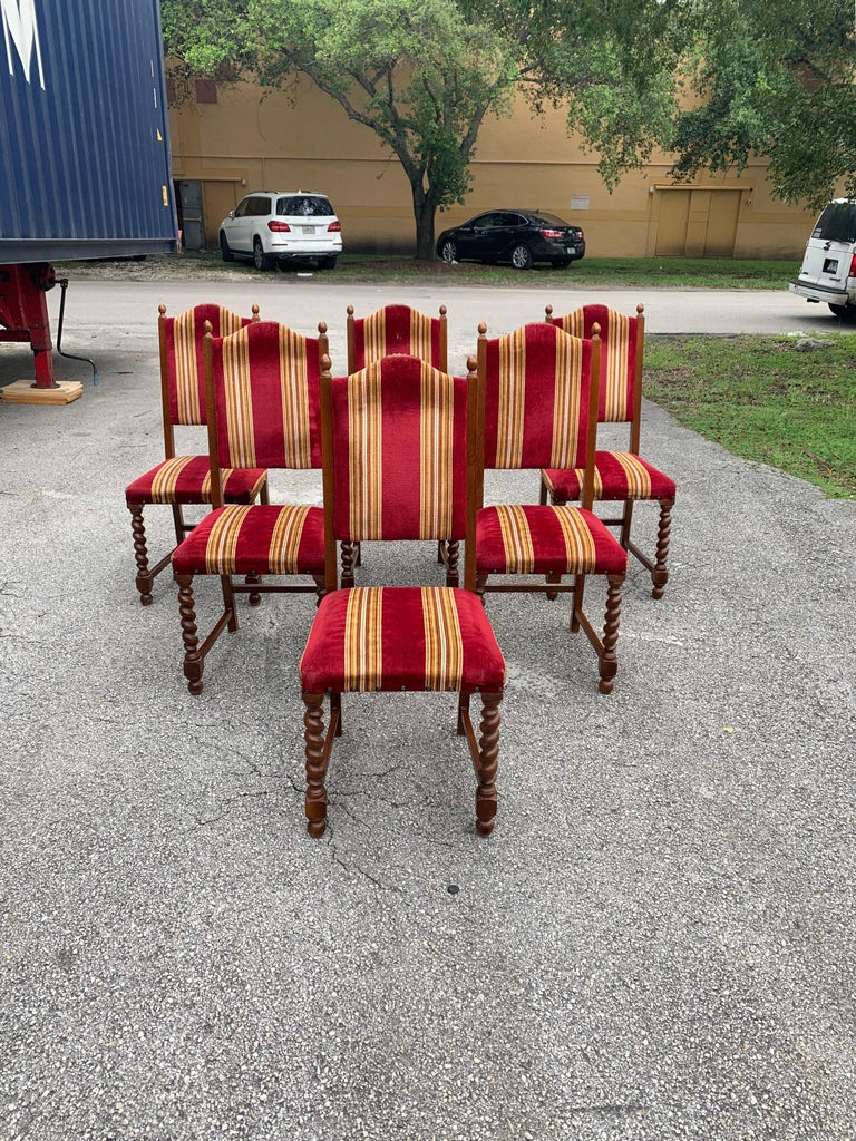 Fine set of 6 Louis XIII style barley twist dining chairs with chapeau de gendarme backs, circa 1880s.? With a deep rich patina, these comfortable chairs are solid and very sturdy, ready for everyday use. ( the velvet Fabric is recommended to be