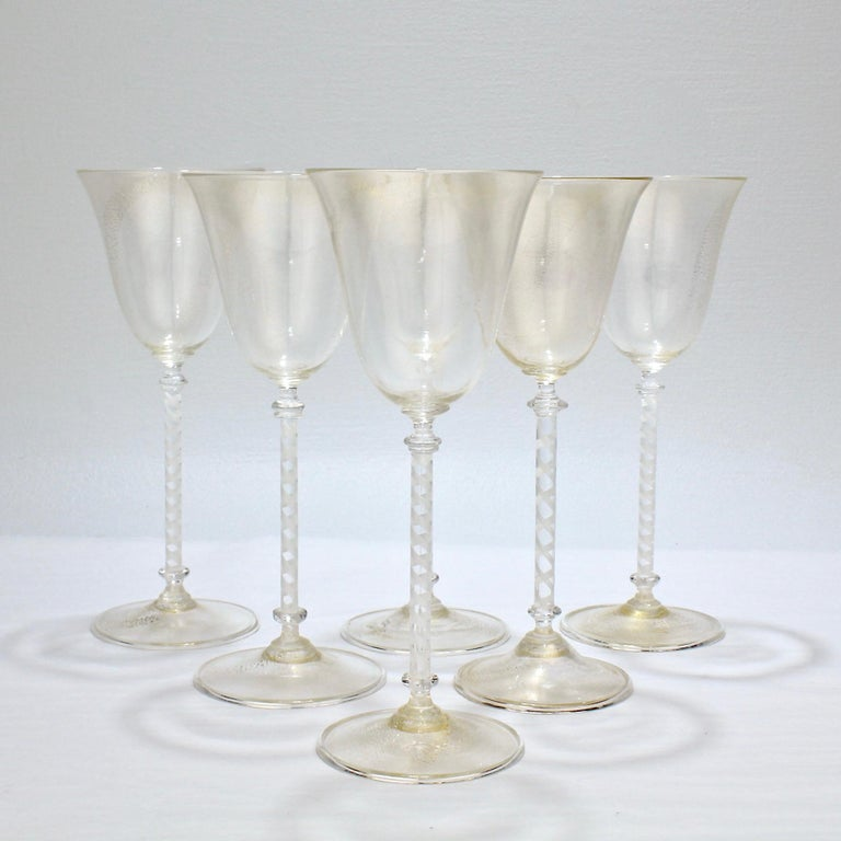A good set of 6 vintage Murano or Venetian wine goblets.  The bowls and feet with gold inclusions and the stems with a twisted white filigrana cane.   Simple and refined wine stems that are perfect for the modern table!  Measures: Height ca. 8 1/2