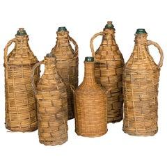 Set of 6 Wicker Wrapped Glass Bottles