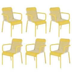 Set of Six Yellow Resin Armchairs