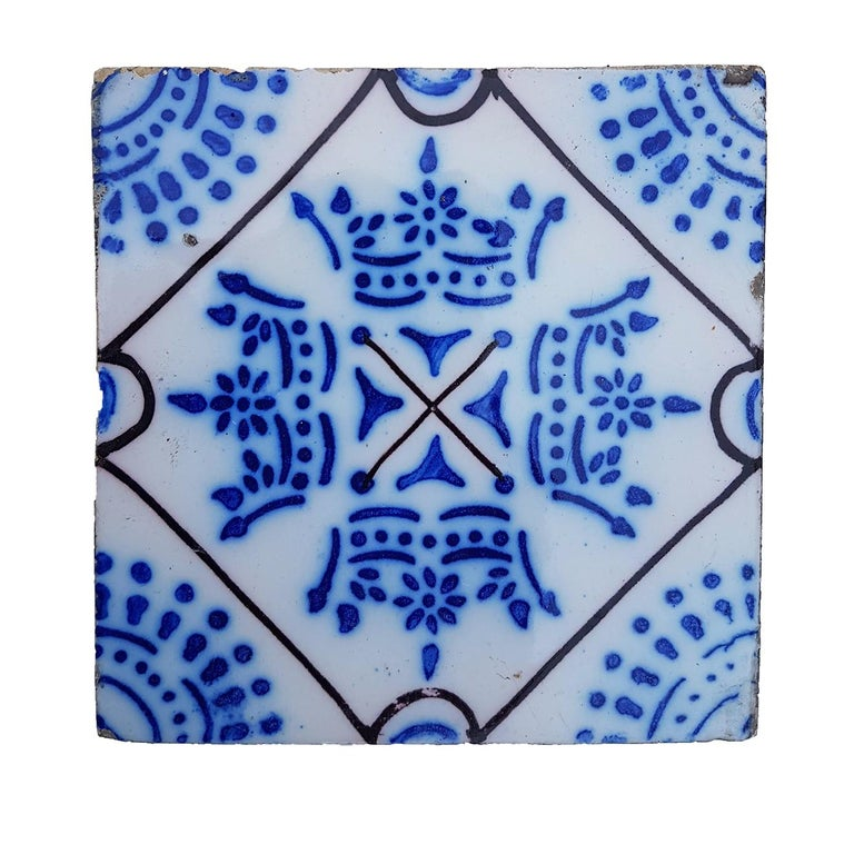 This is a amazing and unique set of 64 antique French handmade ceramic tiles. Manufactured Pas de Calais Desvres, circa 1910s. With different stylized designs. These tiles would be charming displayed on easels, framed or incorporated into a custom
