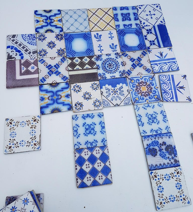 This is an amazing and unique set of 64 antique French handmade ceramic tiles. Manufactured Pas de Calais Desvres, circa 1910s. With different stylized designs. These tiles would be charming displayed on easels, framed or incorporated into a custom