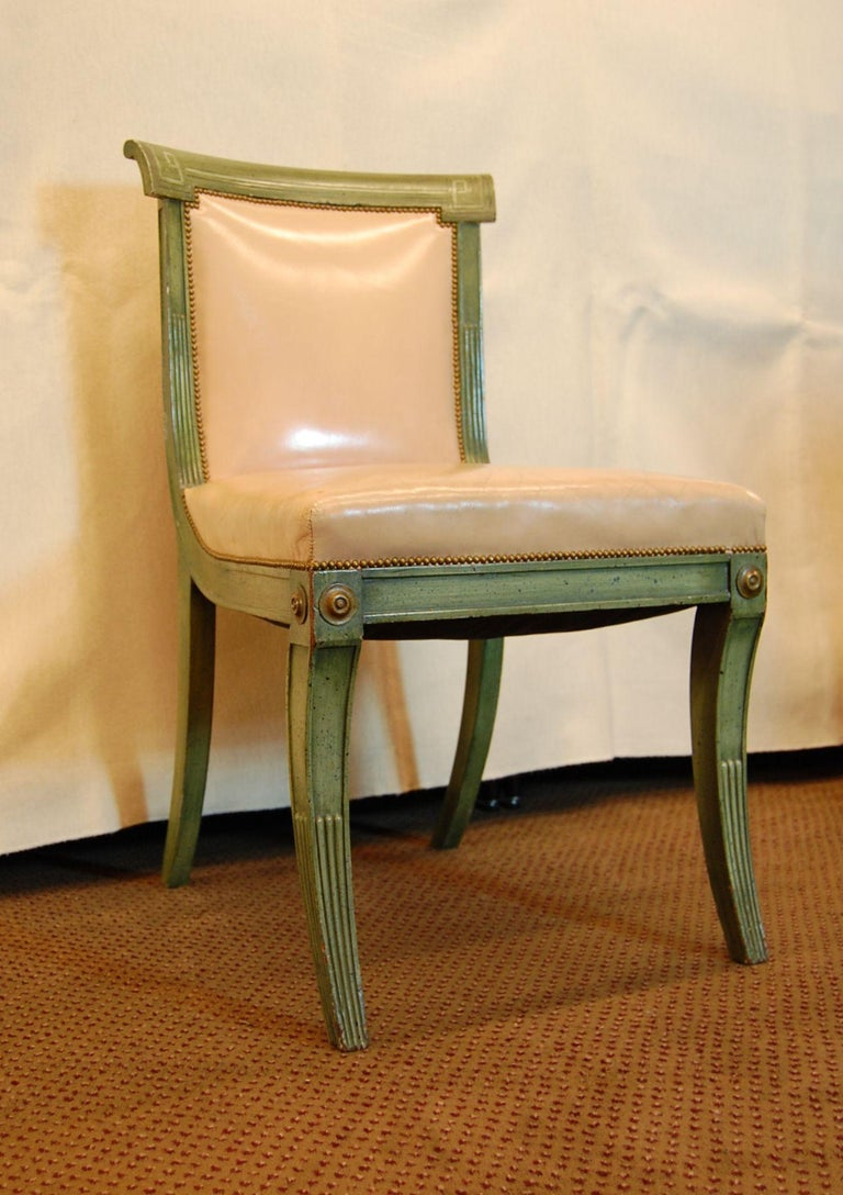7 antique Mahogany chairs in a Regency style polychrome green finish. These solid Mahogany chairs were painted and decorated in the mid-1960s in Pittsburgh by artist Victor Ferbus for Louis Talotta, ASID. Frames are tight and covered in pink