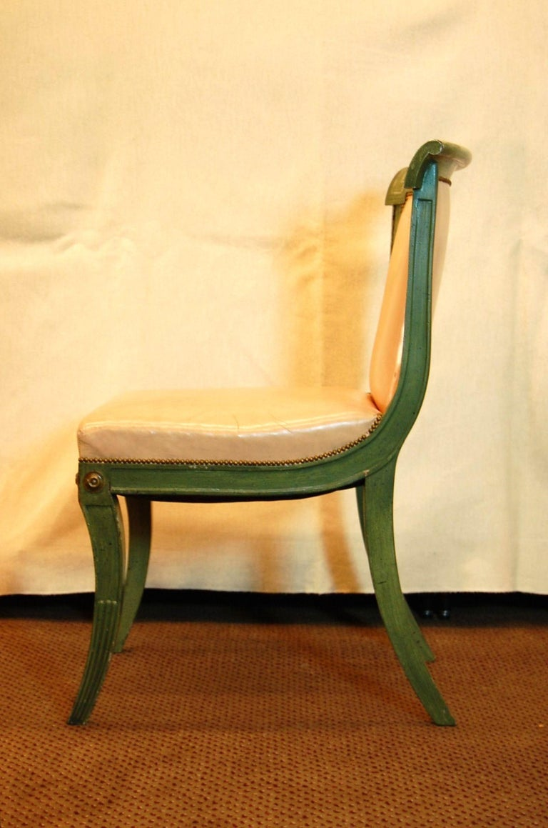 Hand-Carved Set of 7 English Regency Style Green Polychromed Side Chairs with Saber Legs For Sale