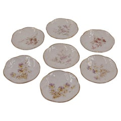 Set of 7 French Victorian Small Gilt Rim Floral Porcelain Plates