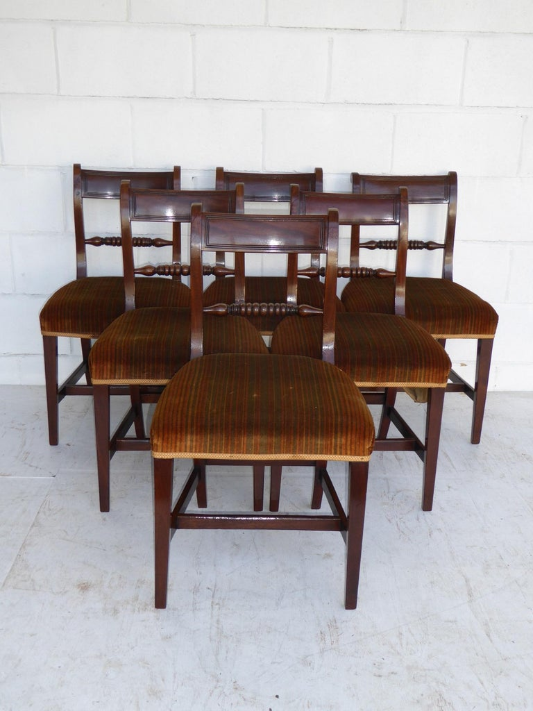 For sale is a set of eight George III mahogany dining chairs. All in good condition having been re-polished by hand.  Carver width 23
