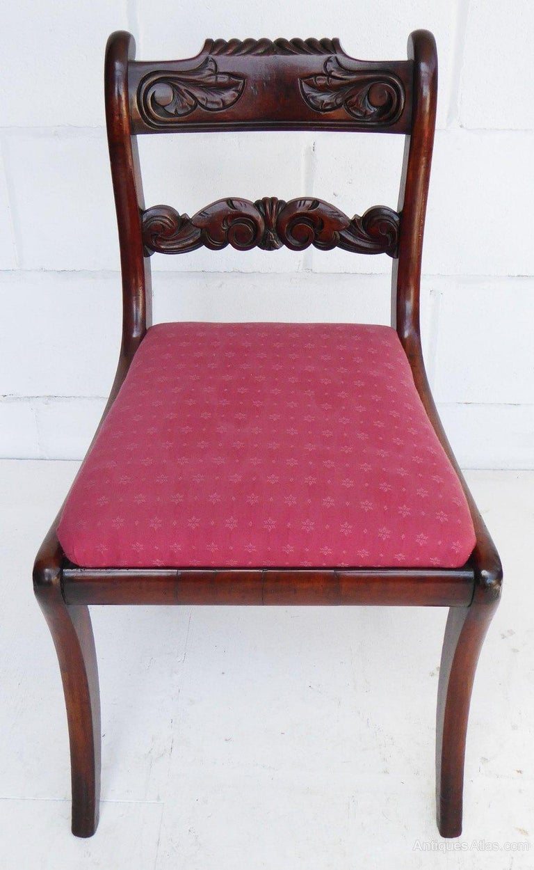 For sale is a good quality set of eight Regency Mahogany dining chairs. Each chair has an ornately carved back at the top and the centre, with drop in seats, the chairs stand on saber legs. Each chair is structurally sound and in good condition,