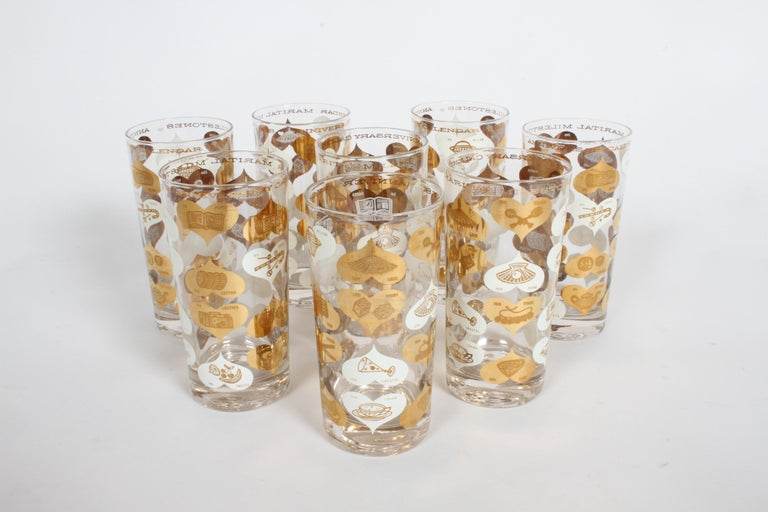 Set of 8 Mid-Century Modern highball barware glasses, titled Anniversary Calendar of Marital Milestones, plated with 22-karat gold. Goes from 1st anniversary of paper to 75th-Diamond. One glass, has small chip to inside rim, going to try to get it