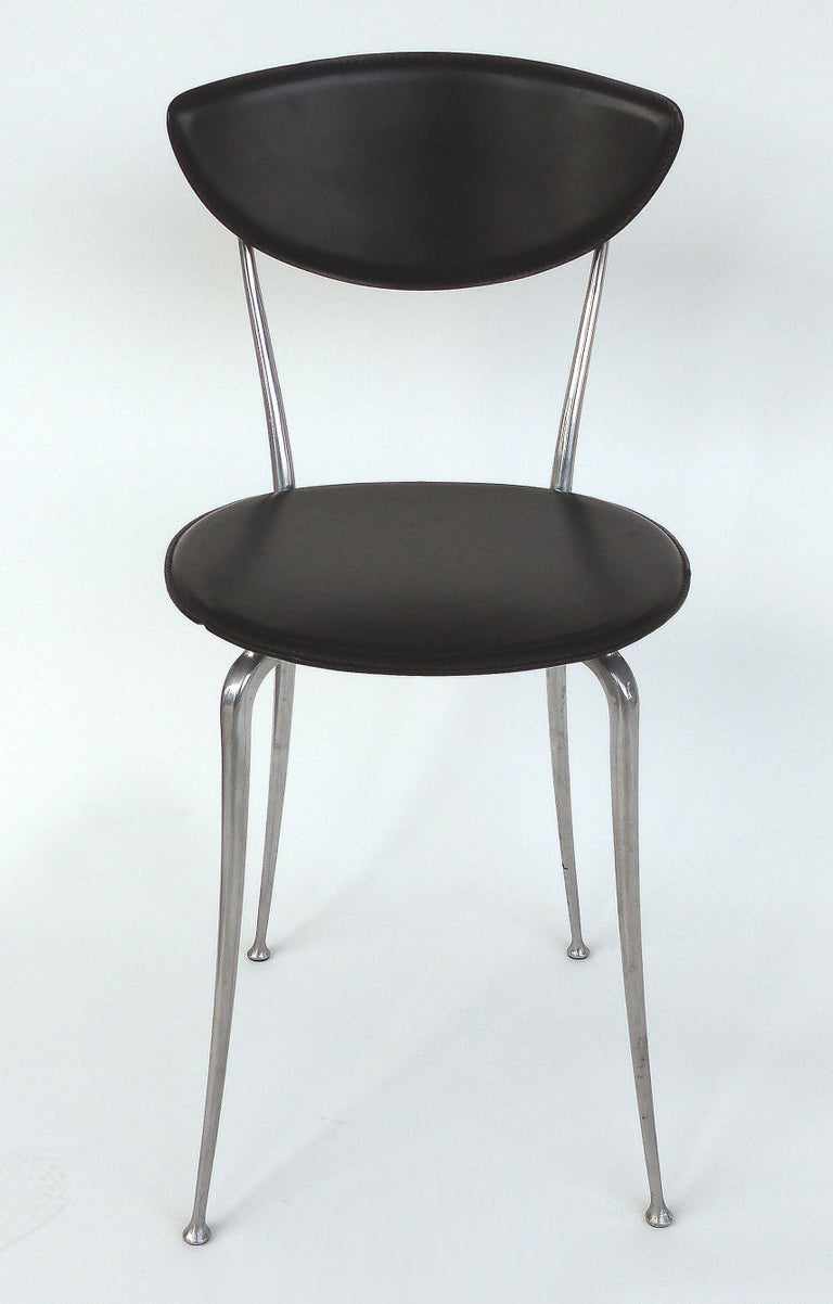 Set of 8 Arper leather and aluminum dining chairs, Italy  Offered for sale is a set of eight dining chairs manufactured by Arper of Italy with leather seats and backs supported by an aluminum frame. These dining chairs are well proportioned yet