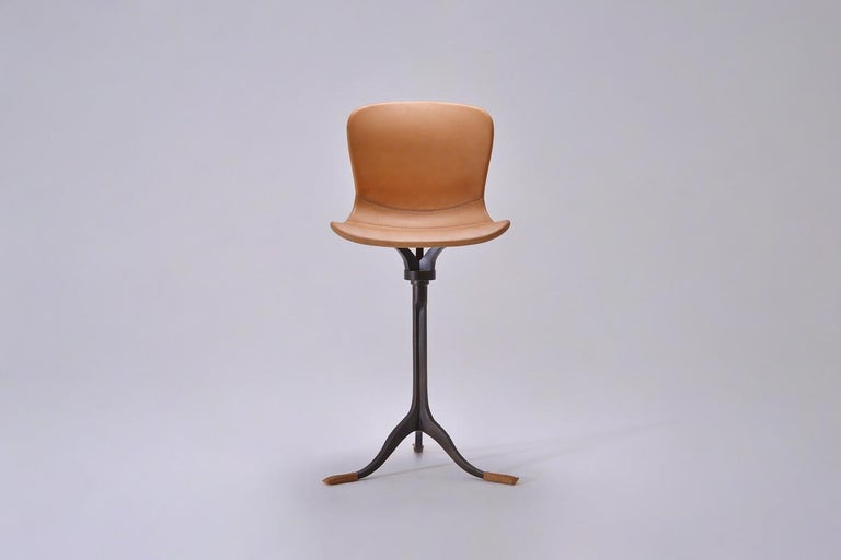 Available to your order, 12 weeks  We created these bar chairs for a client's winter holiday home in Japan.   Model: PT47 counter-height and swivel chair Seat: Leather Seat color: Marron Glacé, buffed and oiled Base: PT47 base, hand cast brass Base