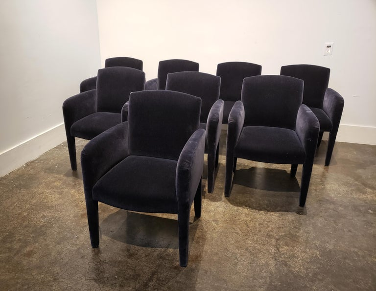 Modern design dining chairs fully upholstered in dark blue mohair manufactured by Donghia. In good condition with light wear to upholstery. Set of 8.  Each chair measures 24