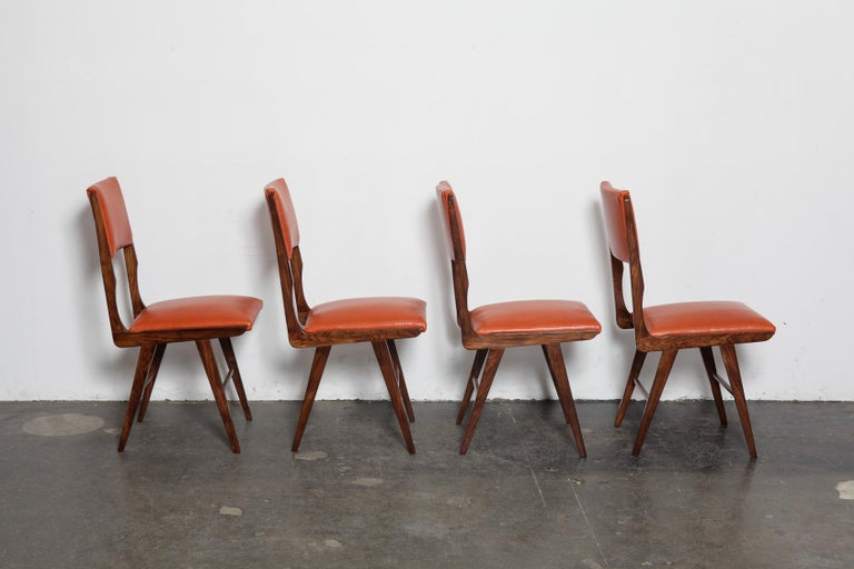 Set of 8 tall back beautiful vintage Brazilian solid rosewood dining chairs, newly upholstered in a burnt orange leather and refinished in lacquer, 1960s Brazil. Designer unknown.