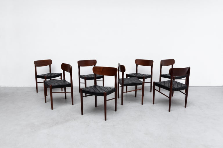 Gorgeous set of 8 Børge Mogensen style Danish dining chairs with black woven faux leather seating and lightly refinished teak frame. In good overall condition with some wear consistent with age and use. Set price.