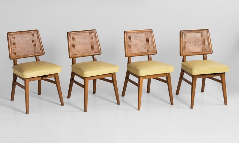 Set of 8 cane back dining chairs, America, circa 1960.