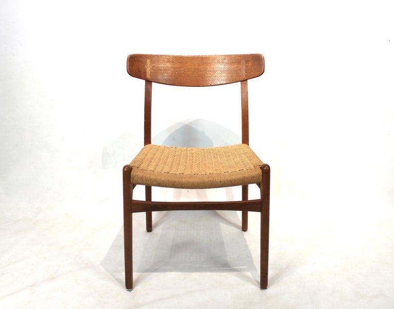 Set of 8 dining chairs, model CH23, designed by Hans Wegner in 1950 and manufactured by Carl Hansen & Son in the 1950s. The chairs are of oak, with seats of paper cord and are all in great vintage condition.