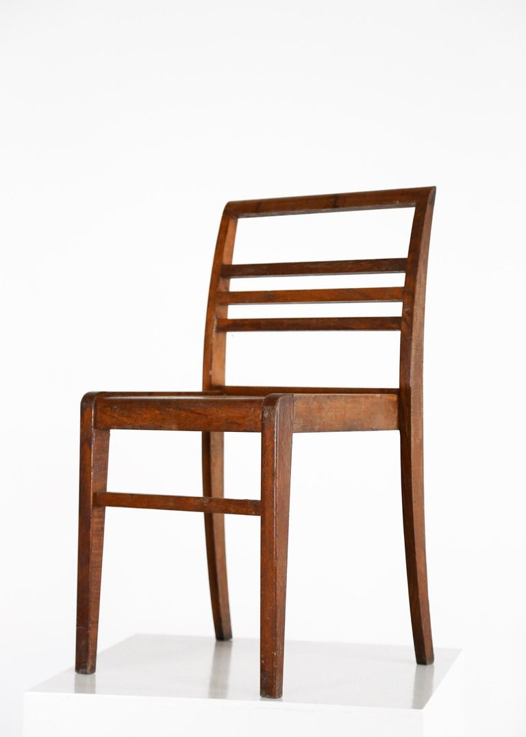 This set, designed by René Gabriel, was produced during the reconstruction after world war II for the victims. Made of oak. 4 stackable chairs standard and 4 reinforcements chairs. Only one restoration one the back of one chair (Cf. photos).