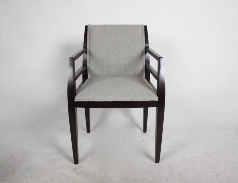 Set of eight Arbat arm dining chairs designed by architect Constantin Boym for Brickell. The chairs bold lines are inspired by Russian Constructivist architecture. Refinished hard maple frames in an ebony stain, includes re-upholstery COM.