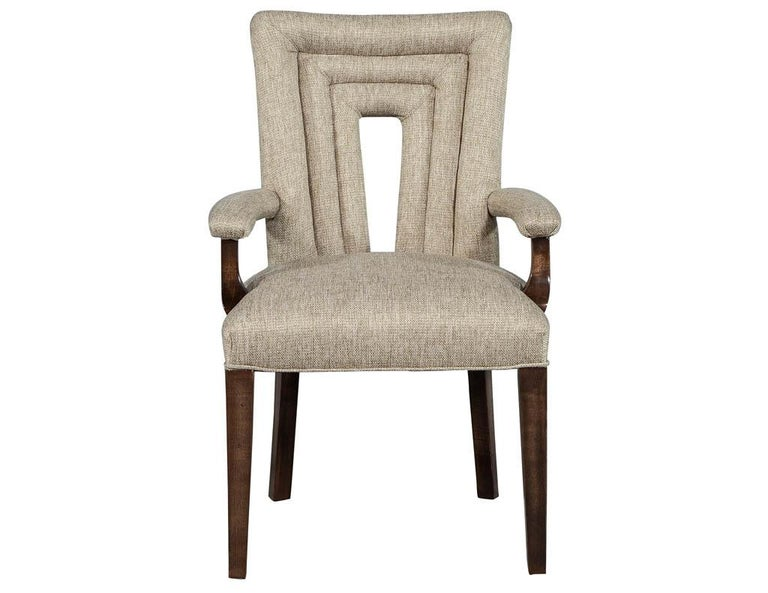 This set of 8 Hilgard dining chairs are a new addition to the Carrocel custom collection. They have a Modern style with a Classic tubular surrounded back. They are elegantly upholstered in a linen and finished in medium walnut stain. These chairs