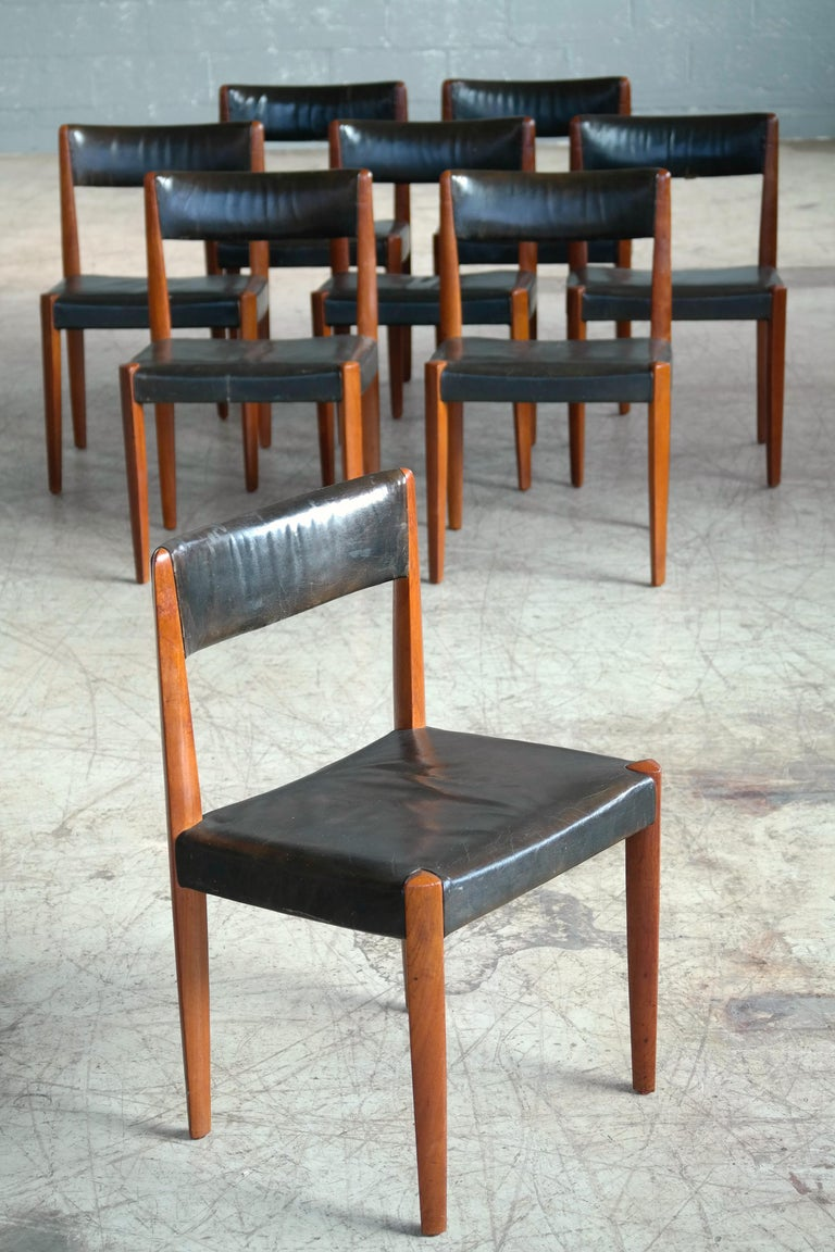 Beautiful and rare set of 8 dining chairs designed by Aage Schmidt Christensen and manufactured by Fritz Hansen as Model # 4112 in the 1950's. Solid carved teak teak with patent leather. The frames show beautiful angles and great color and patina.