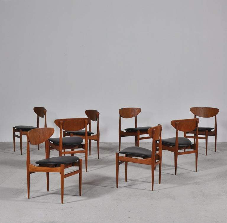 Rare and beautiful dining chairs made in 1963 for Sorø Stolefabrik, Denmark by Italian/Danish designer couple Inge & Luciano Rubino. The chairs features stunning details in teakwood and newly upholstered seats in black aniline leather.