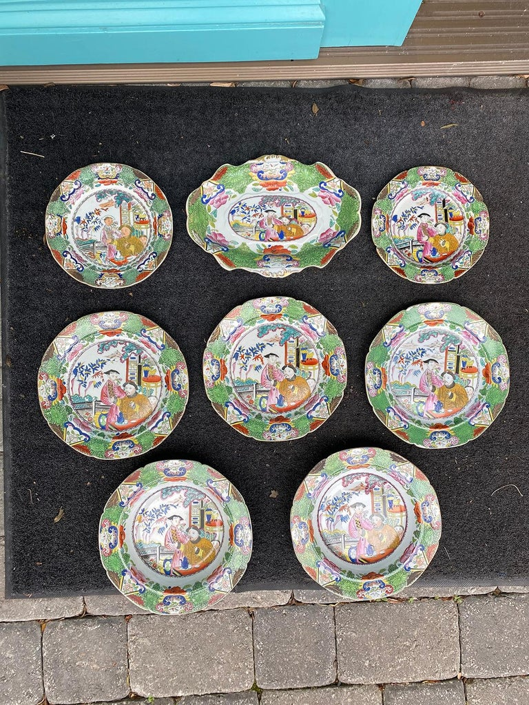 Set of Eight Early 19th Century Circa 1800 English Mason's Enameled Ironstone China Plates in Mandarin pattern. All marked.  Dimensions: Oval dish with gilt edges:11