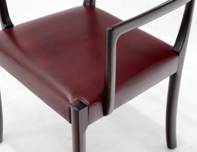 Set of 8 Danish Mid-Century Modern dining chairs or armchairs. Solid rosewood frames deep chocolate near bronze finish. Rock solid condition.