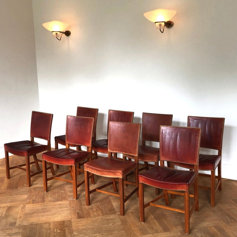 KAARE KLINT & RUD RASMUSSEN SNEDKERIER - SCANDINAVIAN MODERN  A set of eight Kaare Klint 'Red Chairs', small model, all acquired from the same provenance.  Profiled legs of mahogany, seat and back with original red Nigerian goat leather and fitted