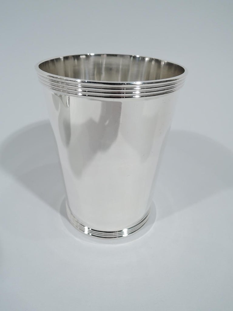 Set of 8 sterling silver mint julep cups. Made by Frank M. Whiting in North Attleboro, Mass. Each: Straight and tapering sides, and reeded rim and foot. Nice and traditional. This maker active until circa 1960. Fully marked including maker's stamp,