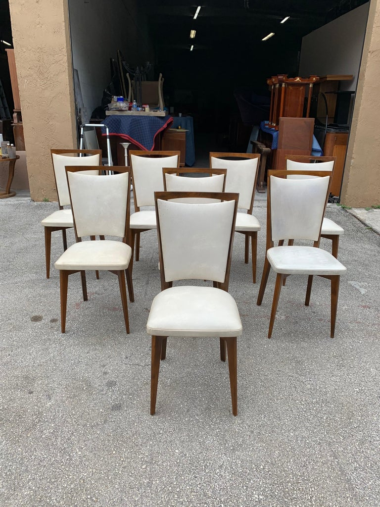 Classic set of 8 French Art Deco dining chairs solid mahogany, the chair frames are in excellent condition. The reupholstery is vinyl recommended to be change for all 8 dining chairs but the vinyl look good, the dining chairs are beautiful, circa