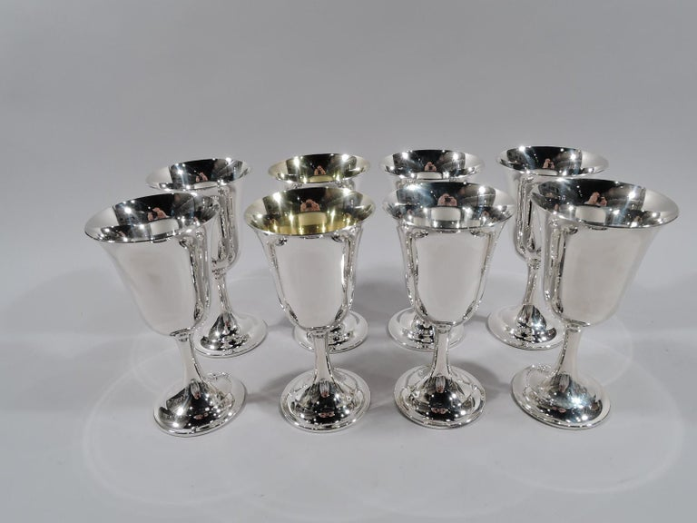 Set of 8 Lord Saybrook sterling silver goblets. Made by International in Meriden, Conn. Each: Tapering bowl with fluted rim, cylindrical stem, and raised foot. Two goblets have gilt-washed interior. A graceful and traditional form that works just as