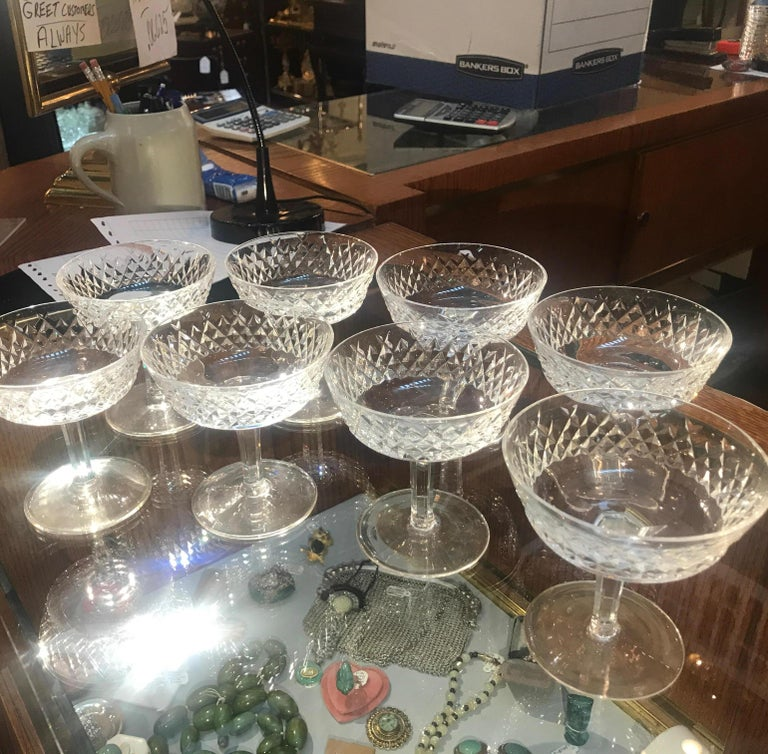Handcut Irish crystal champagne coupes by Waterford. Handcut and polished by an expert glass cutter from Waterford in the retired Alana pattern. These are great for champagnes or as a footed dessert dish.