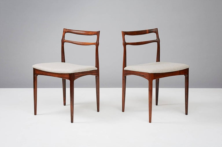 Johannes Andersen (1903-1991)  Rosewood dining chairs, produced circa 1960s  Sculptural Brazilian rosewood dining chairs produced by the Christian Linneberg Furniture Factory, Denmark. Seats reupholstered in Kvadrat Divina wool felt.