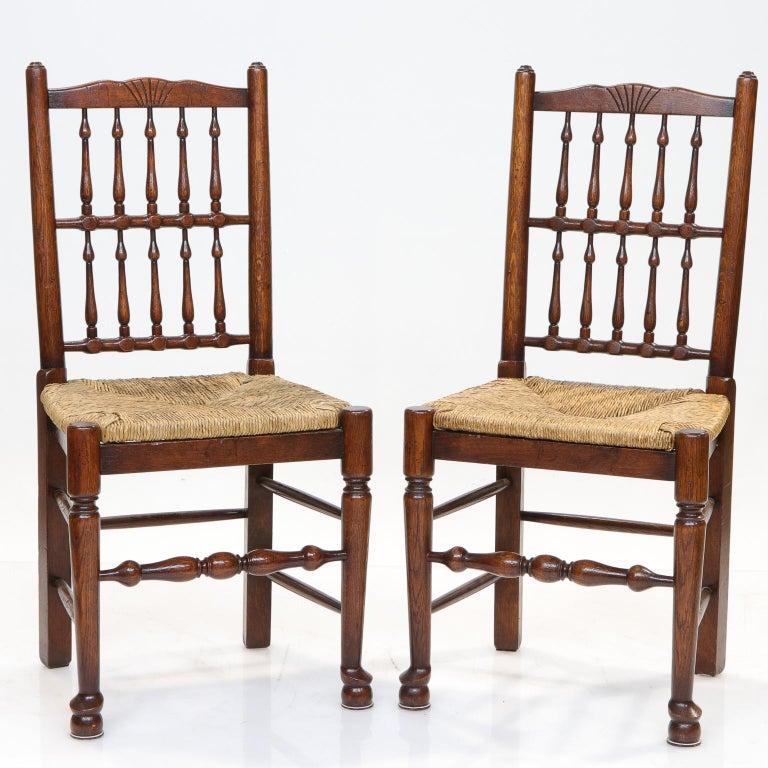Set of 8 Lancashire dining chairs   Very nice set of Lancashire dining chairs with rush seats. English oakwood. Spindle backs.  Measures: 19.25