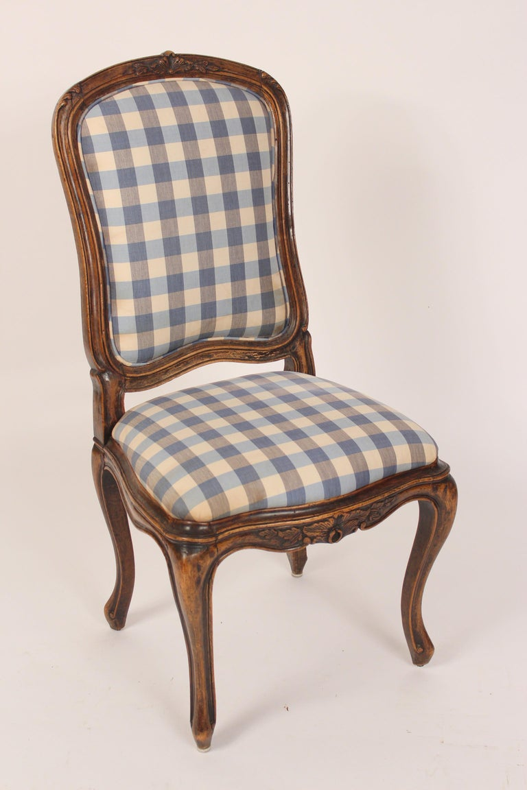 Set of 8 antique Louis XV provincial style beechwood dining room chairs, 19th century. These chairs have an excellent old patina. The chair seat measures 16