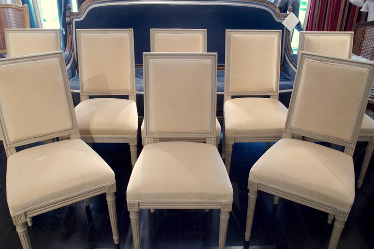 """Set of 8 Louis XVI style chairs, upholstered in velvet  Total dimensions: 18"""" W x 36.5"""" H x 17"""" D Sitting height: 20""""  Height of back: 17.5"""" Seat dimensions: 16.25"""" W x 15.25"""" D."""