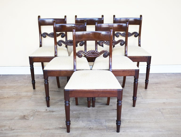 For sale is a set of 8 mahogany dining chairs, each with bar backs above a carved central rail, 19th century. Each chair has a drop in seat and stands on finely turned legs. All of the chairs are in good condition being structurally sound, there are
