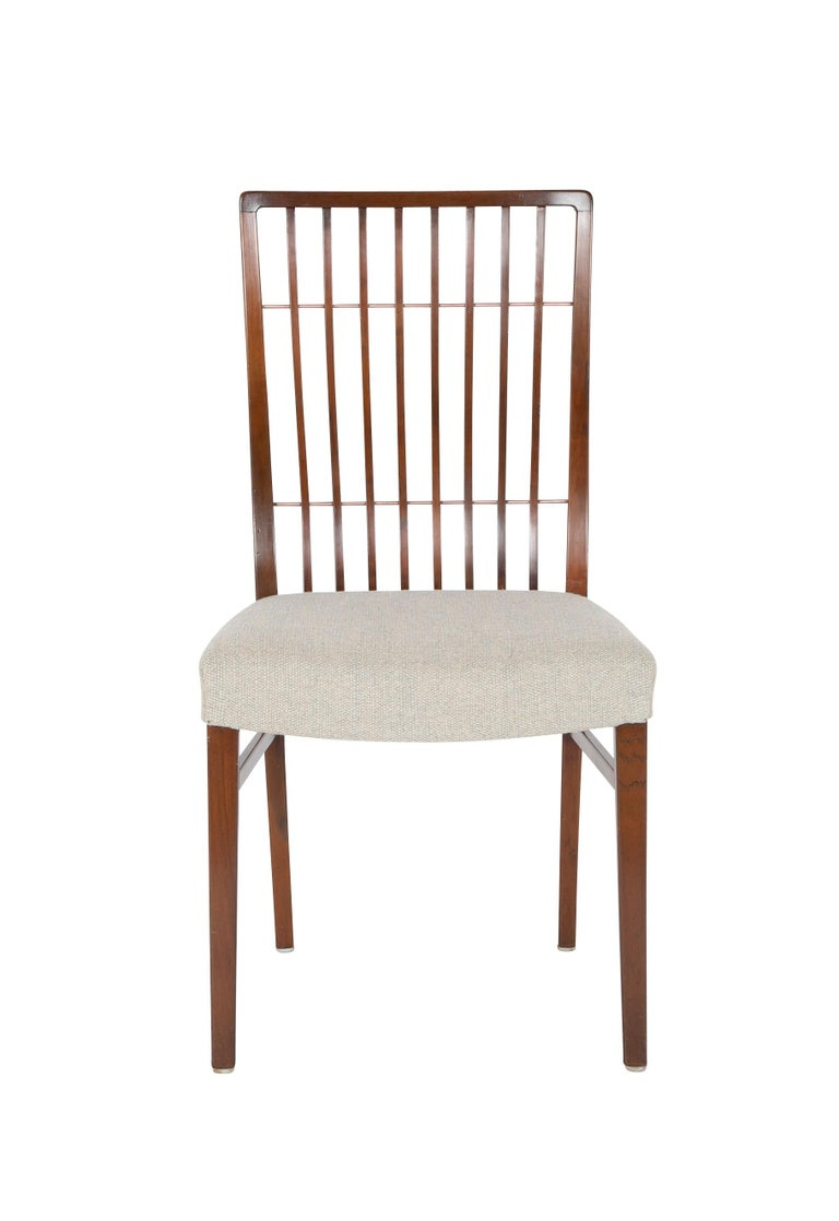 Set of 8 Mid-Century Danish dining chairs of mahogany with copper accents.