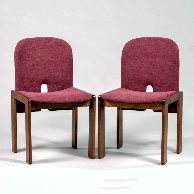 Set of eight Cassina chairs designed by Afra and Tobia Scarpa, circa 1960s. Walnut frames have been professionally refinished and seats and backs are newly upholstered in burgundy colored chenille. Sold and priced as a set of eight.