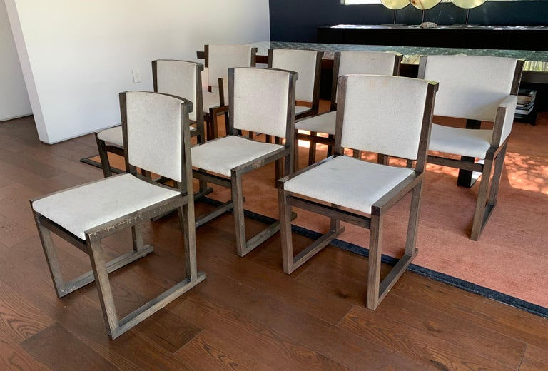 Beautiful set of 8 dining chairs designed by Antonio Citterior for Maxalto/B&B Italia. The set is made of 2 armchairs and 6 side chairs, upholstered in cream color fabric, they all show wear on the frames and seats and need to be cleaned and the