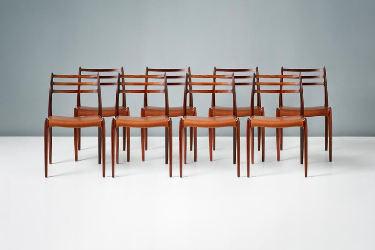 Niels O. Møller  Model 78 dining chairs, 1962  Set of ten rosewood dining chairs designed by Niels O. Møller for J.L. Moller Mobelfabrik, Denmark, 1962. Seats reupholstered with premium aniline cognac brown leather.   Larger sets and other