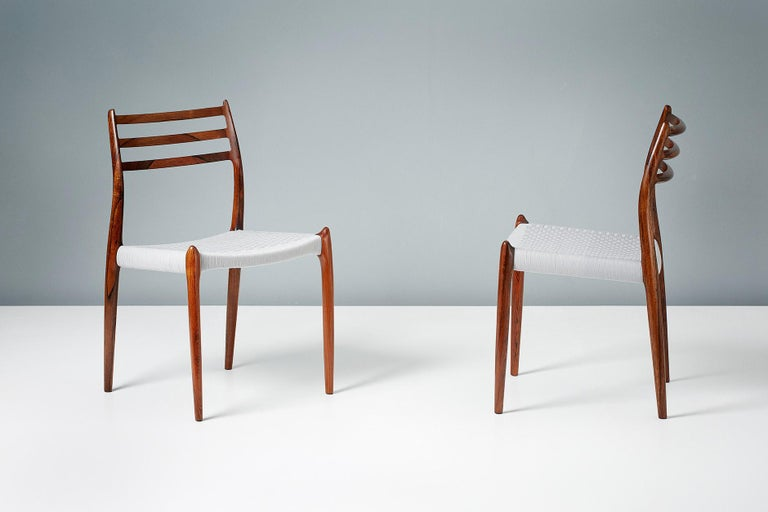 Niels O. Møller  Model 78 dining chairs, 1962  Set of 8 iconic model 78 dining chairs designed by Niels O. Møller for J.L. Moller Mobelfabrik, Denmark in 1962. The frames are made from highly figured, exquisite Brazilian rosewood, the finest of